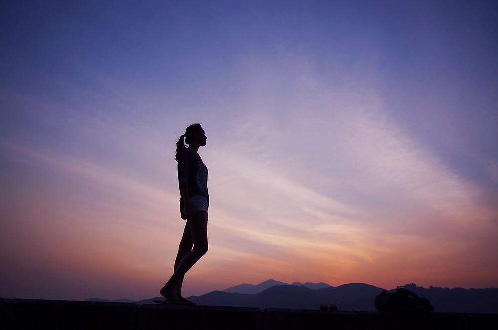 Praying Christian standing firm in Jesus Christ