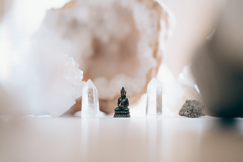 buddha statue and crystals background