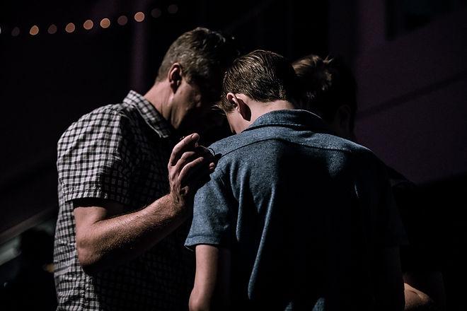 Two men pray