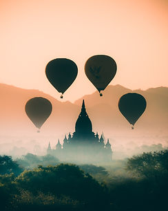 Hot air balloons ascending into the sky