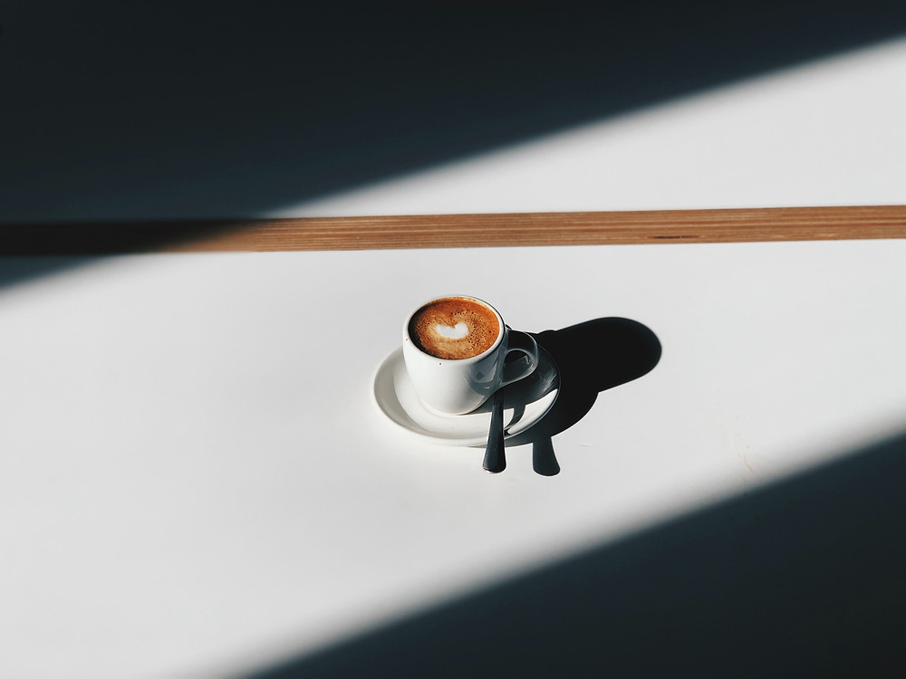Coffee cup and saucer with shadow