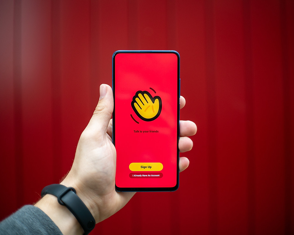 Hand Holding Phone with houseparty app pulled up. Photo by Mika Baumeister