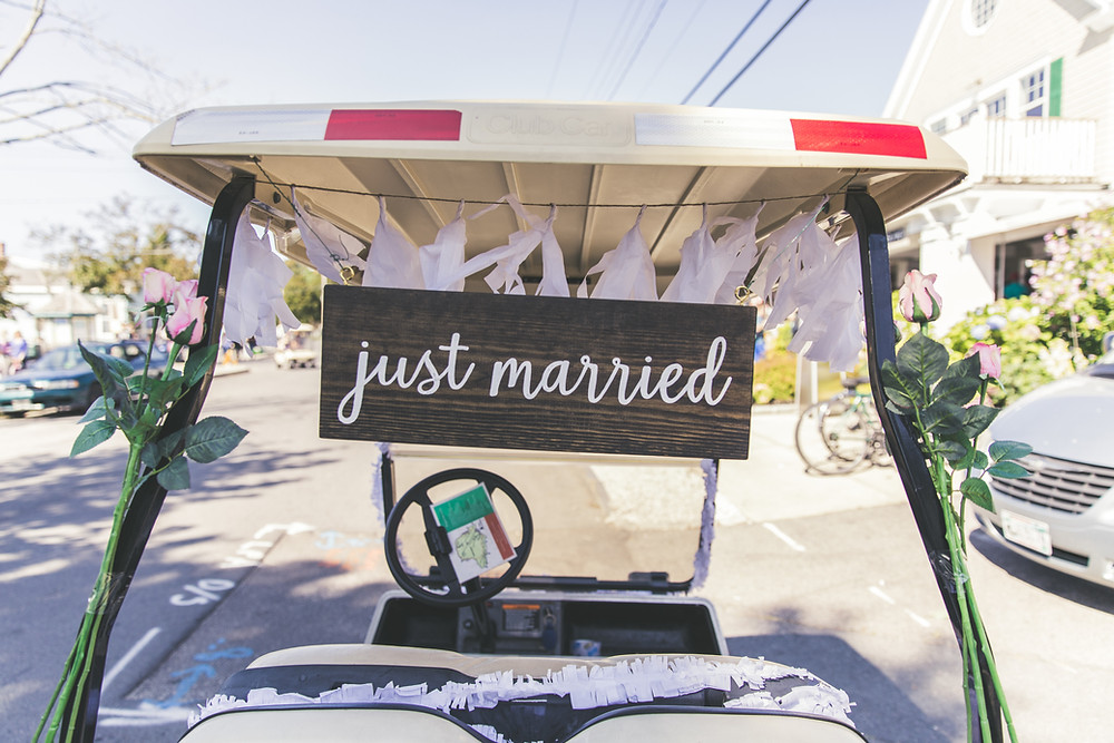 Golf cart decorated with wedding sign (Just Married) In the oitavos golf course. Be prepared to play golf if you want