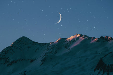 mountains with night sky scene showing the moon