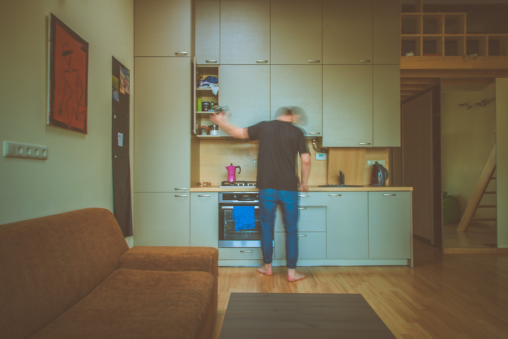 Man alone in kitchen