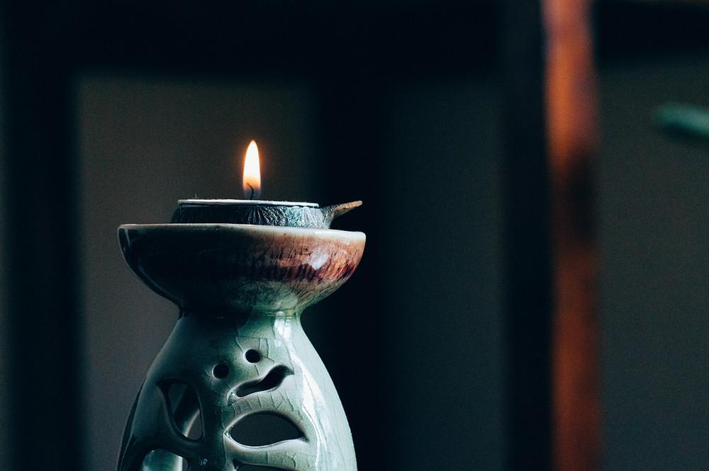 Lit candle on fancy holder