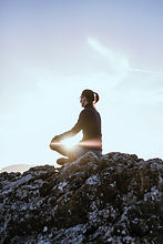 Person Peforming Mindfulness Meditation Outdoors
