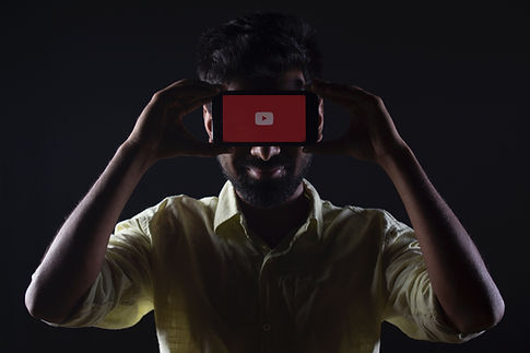 A man holding mobile and YouTube opened in mobile