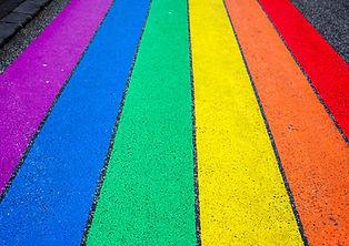 LGBTQ Rainbow Flag on Road Image by Jasmin Sessler