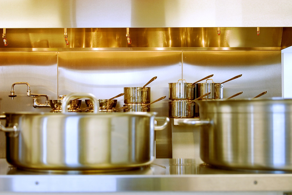 Stainless steel pots and pans in a commercial kitchen