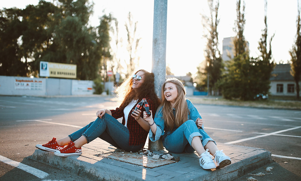 Two girls laughing drinking coke ethics good decision making online homeschool interactive live classes for kids online class
