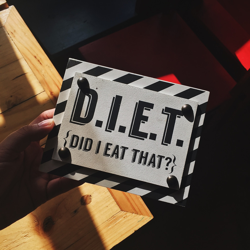 Sign reads D.I.E.T Diet I Eat That