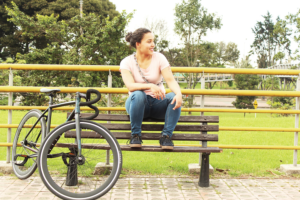 woman sitting on bench waiting