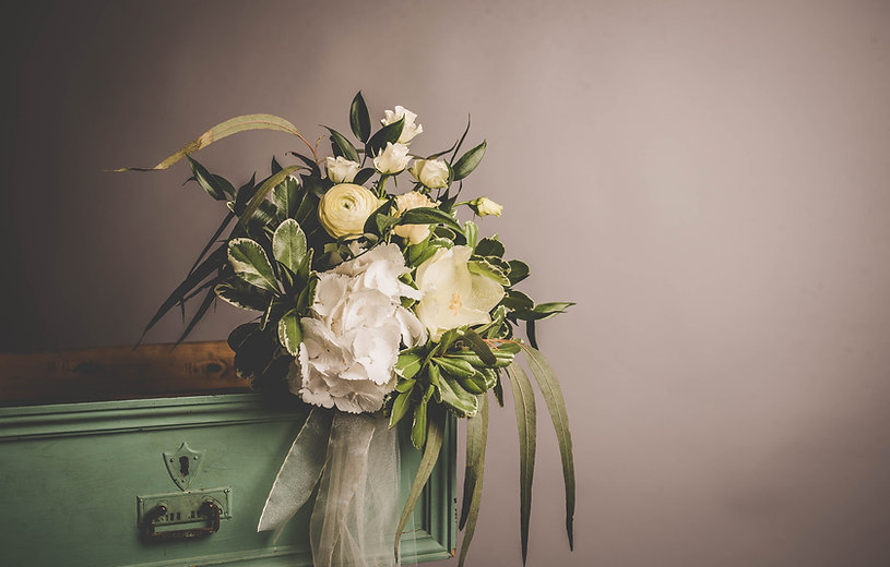 Bouquet of white, yellow and green funeral flowers
