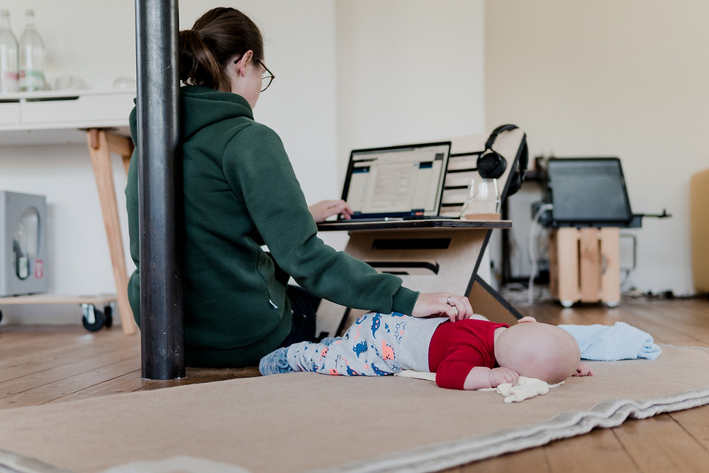 Woman participates in online counsling for postpartum depression shortly after having a baby. Catalyss Counseling provides treatment for postpartum depression in Colorado through online therapy and in person counseling in the Denver area 80209 and 80210