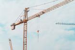 crane lifting in skyline