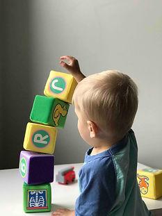 Child building block tower