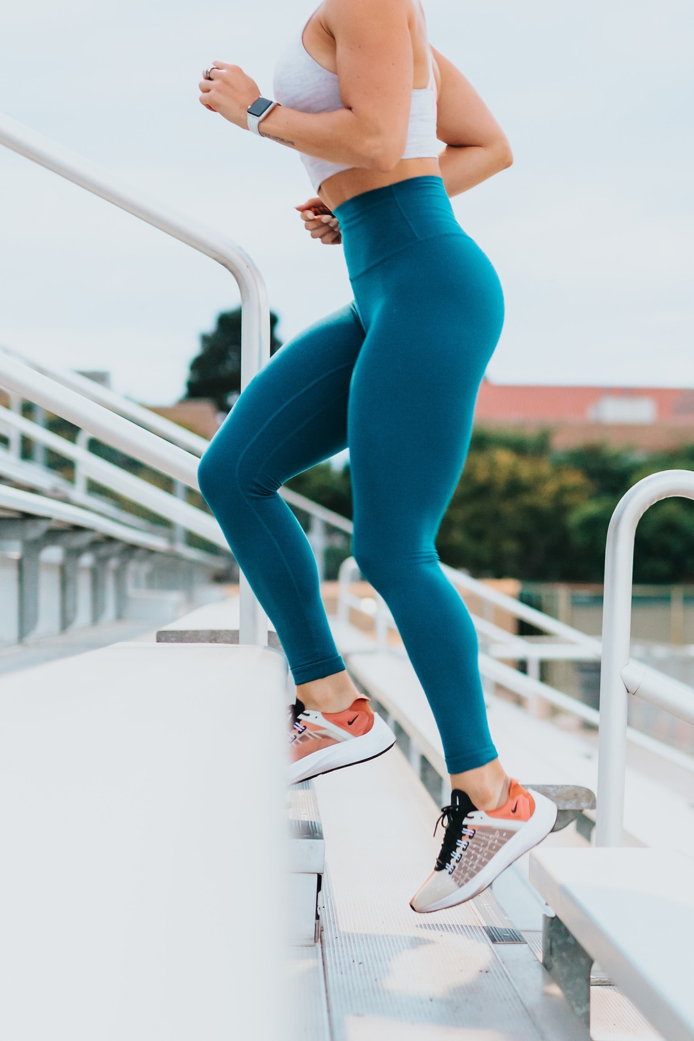 woman running on bleachers increases heart rate