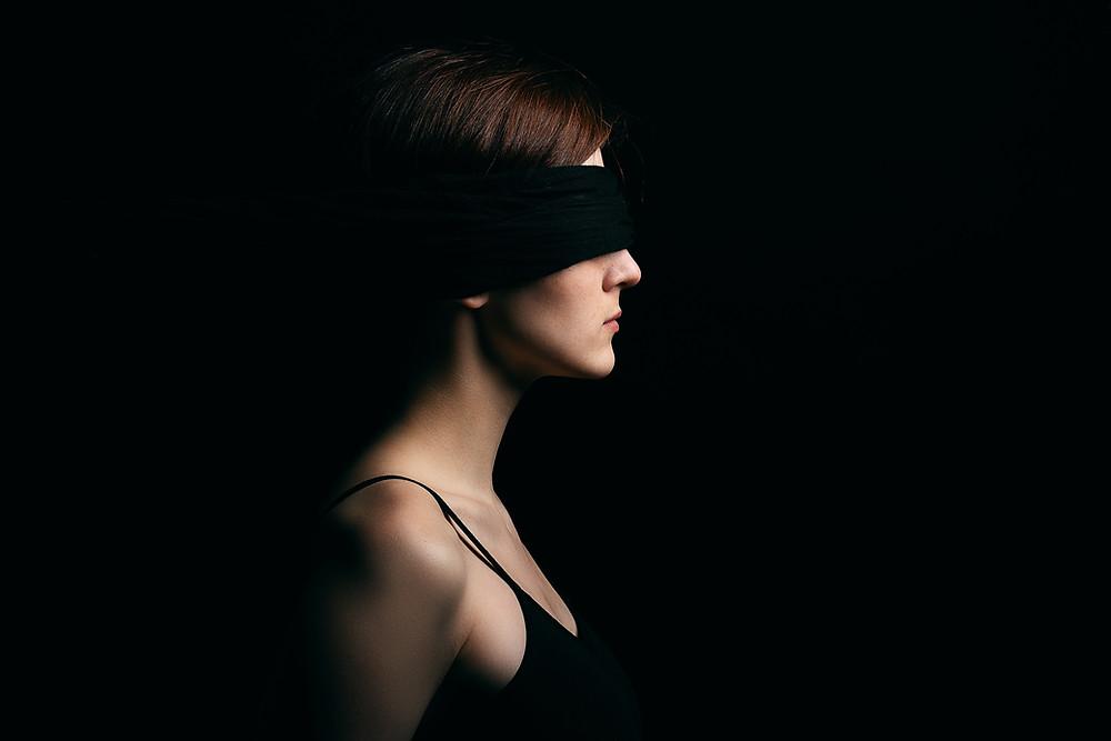 Erotic Woman with blindfolded eyes