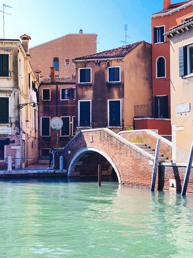 a beautiful canal and bridge in Venice by Rahul Chakraborty