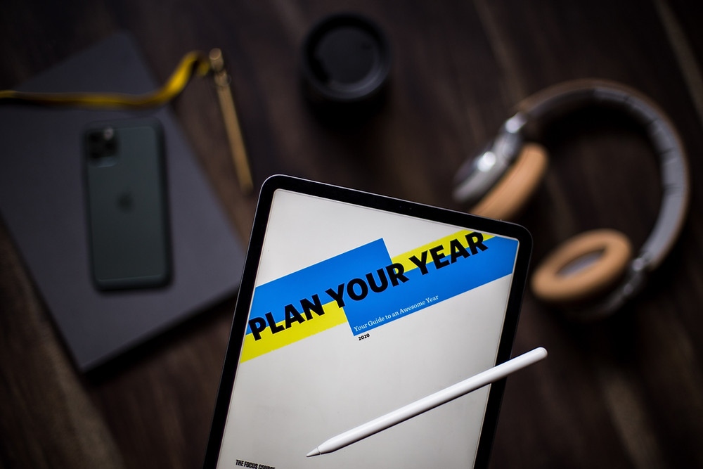 tablet with 'plan your year' and pencil above desk