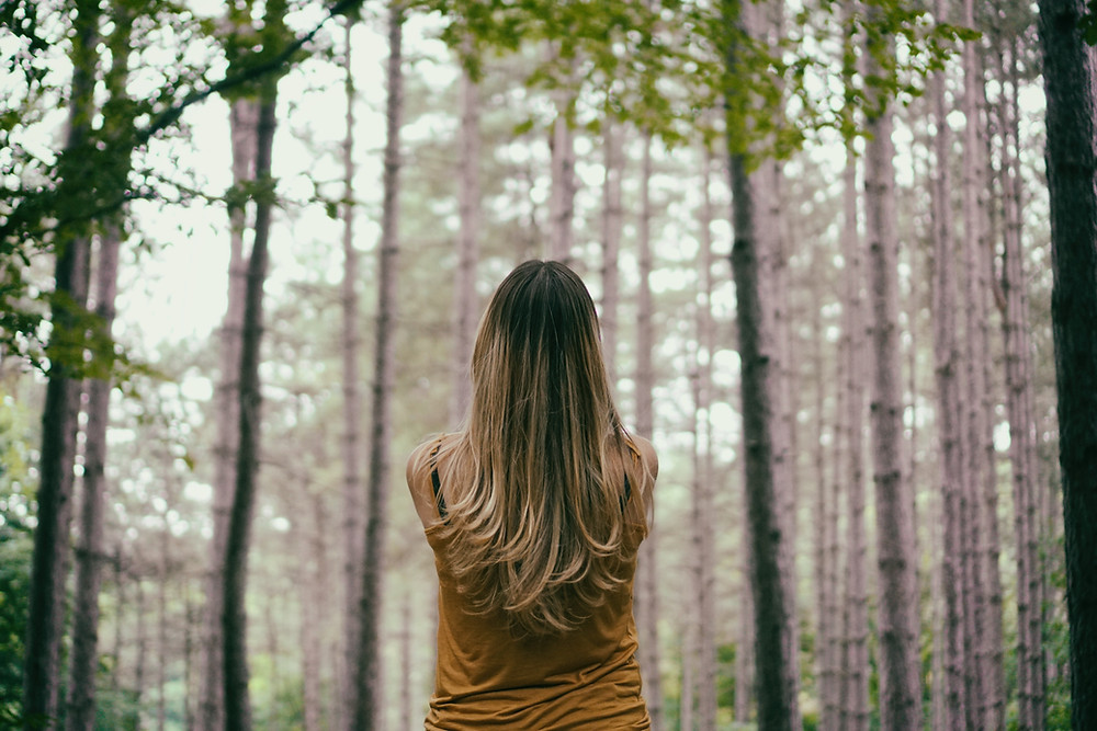 Woman exploring the woods