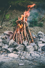 campfire, rocks, sticks and fire at the top, Image by Vadym Lebedych