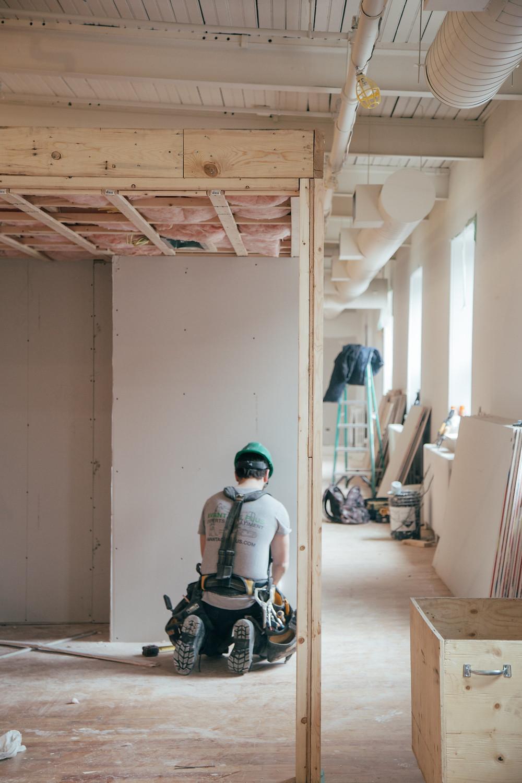 Man fitting a wall