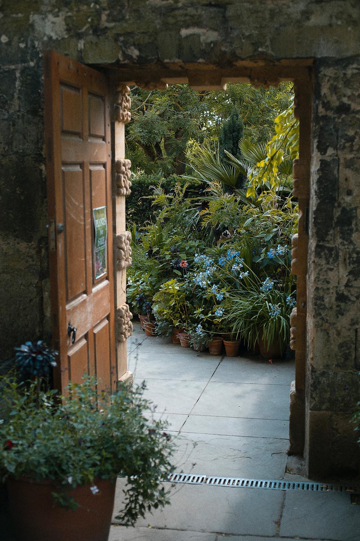 Door open into outside garden.