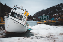 a fishing boat landed on shore.