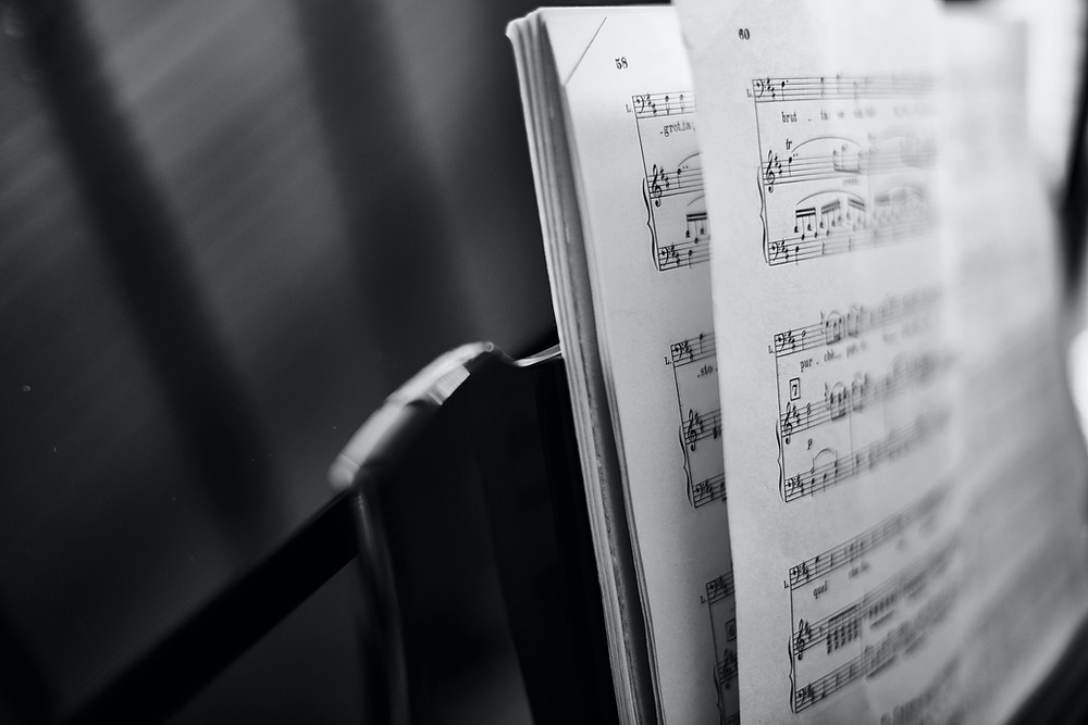 An open book of music on a music stand