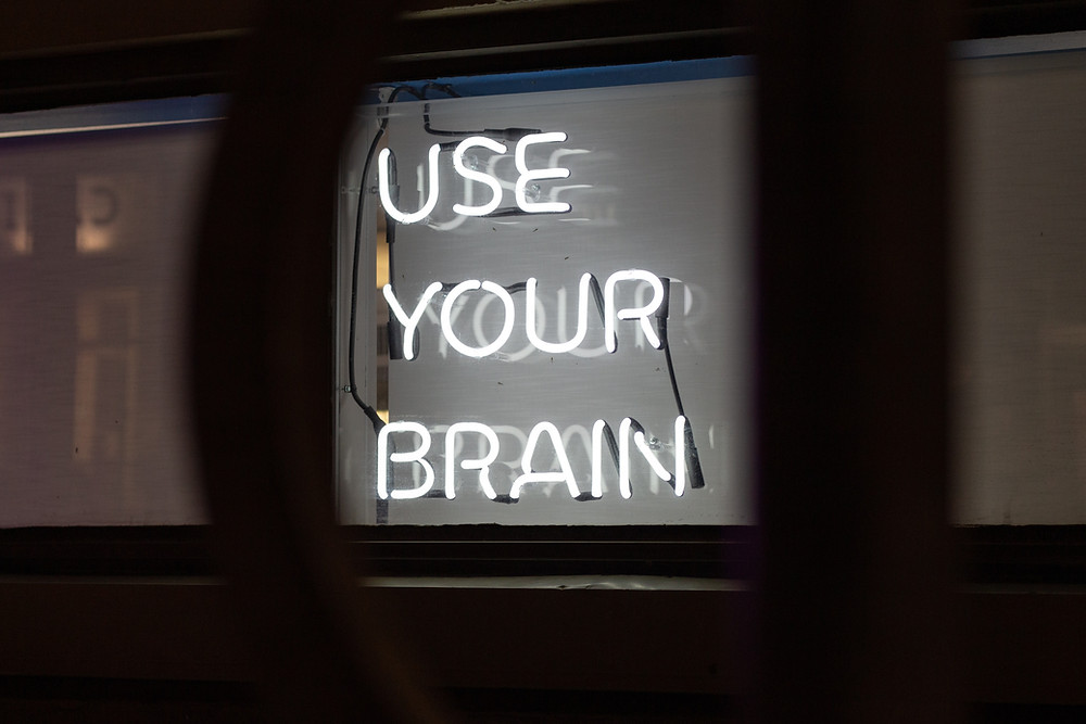 neon sign that says use your brain