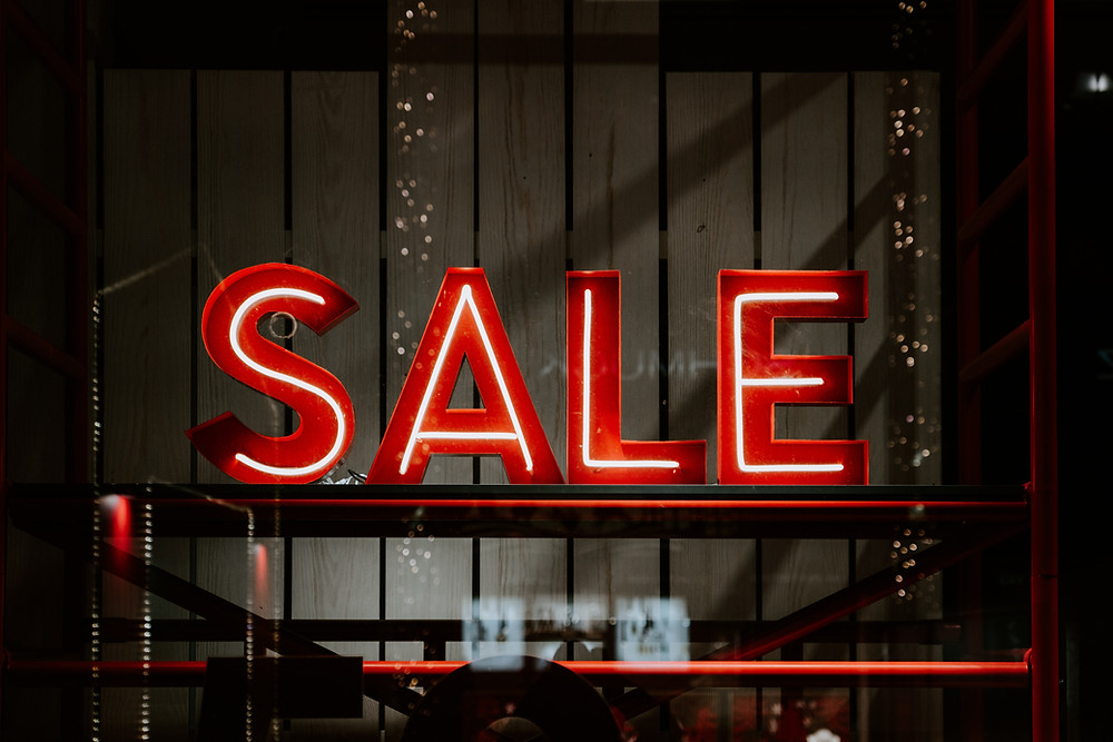 Neon sale sign in window