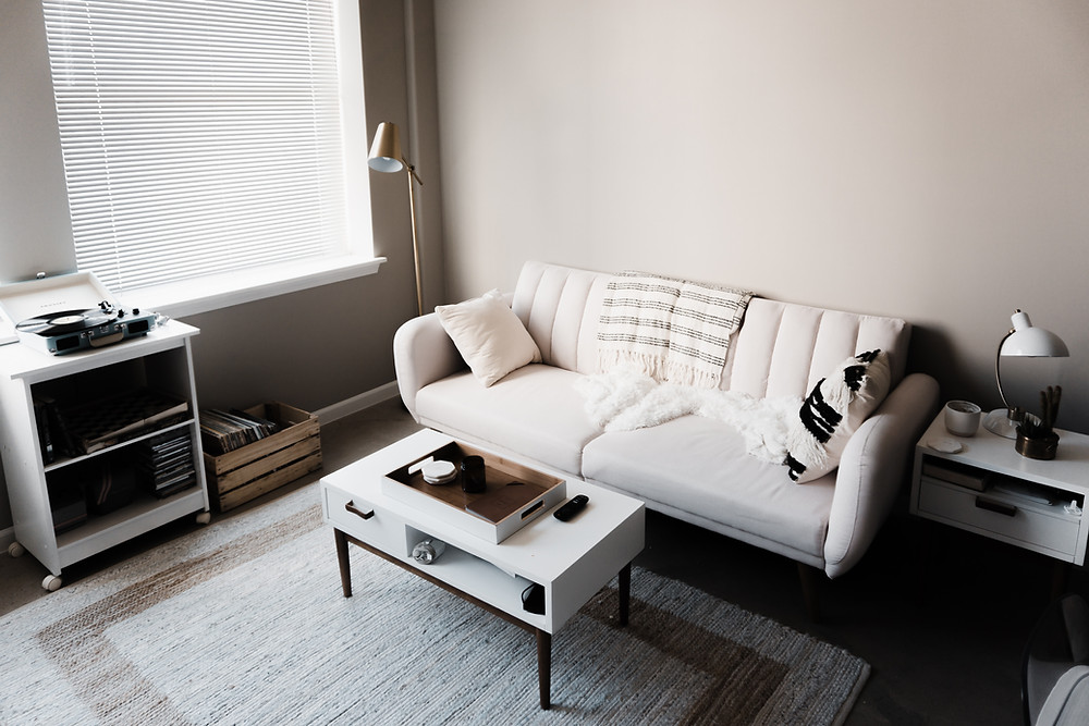 simple living room with couch at Ash Street Coop