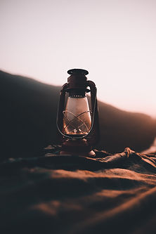 Avalanch lighting - image of old fashioned oil lantern with sunset background
