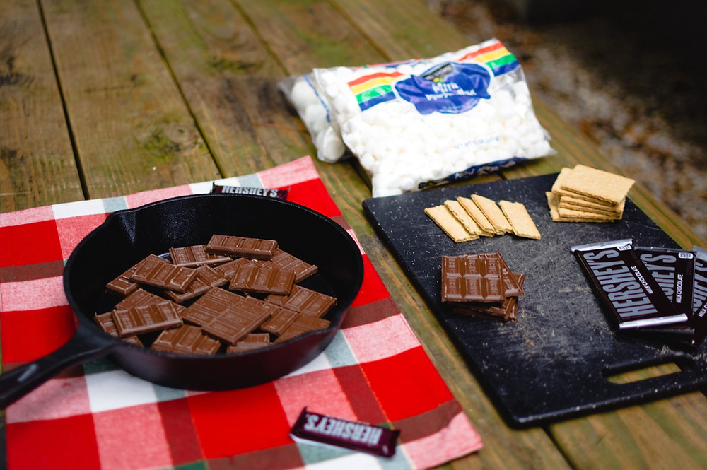 s'more ingredients Hershey chocolate bars, cast iron pan, marshmallows and graham crackers