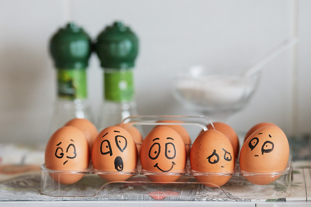 eggs with funny faces drawn on them