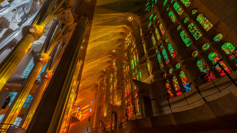 sunlight streaming through the stained glass windows of Sagrada Familia