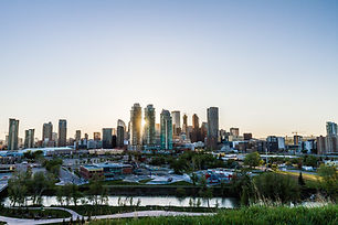 View of downtown Calgary at sunset. THe gorgeous bowriver is flowing in front of downtown. Plan my trip to Calgary, Alberta