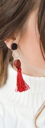 red thread on earrings