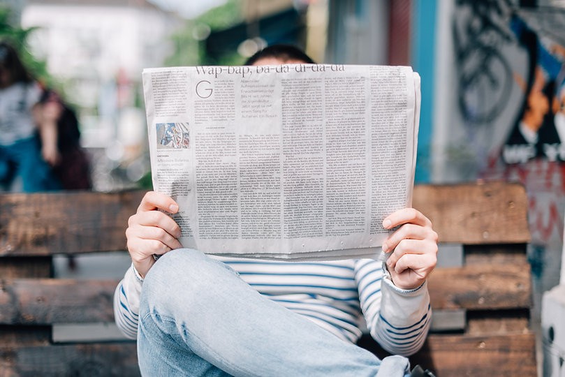 Person holding a newspaper