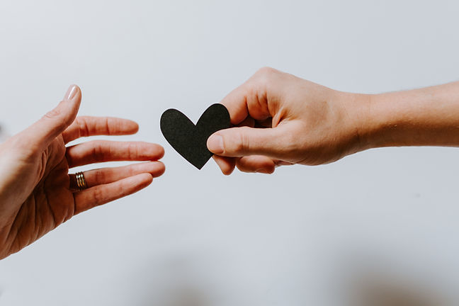 Person holding black heart   breakup recovery   therapy for breakups in Chicago, IL   relationship therapy for singles   relationship therapist   63122   forrest glen 60630   Lincoln Park is 60614   north center 60613   60618