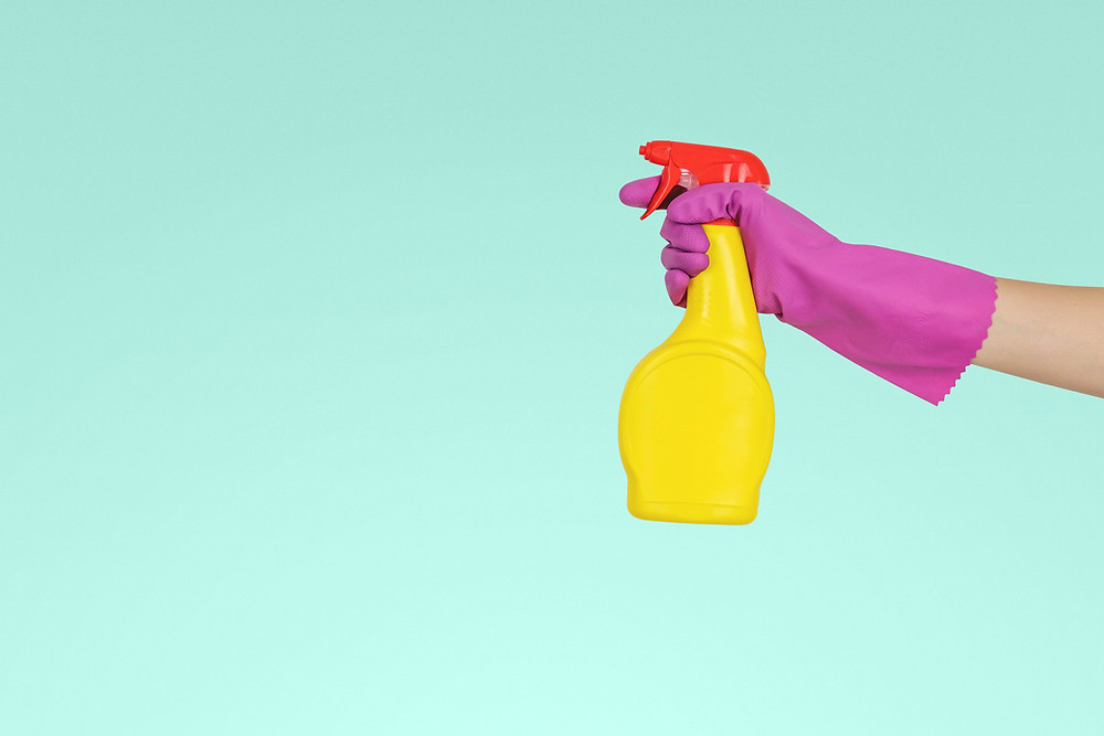 spray bottle and rubber gloves