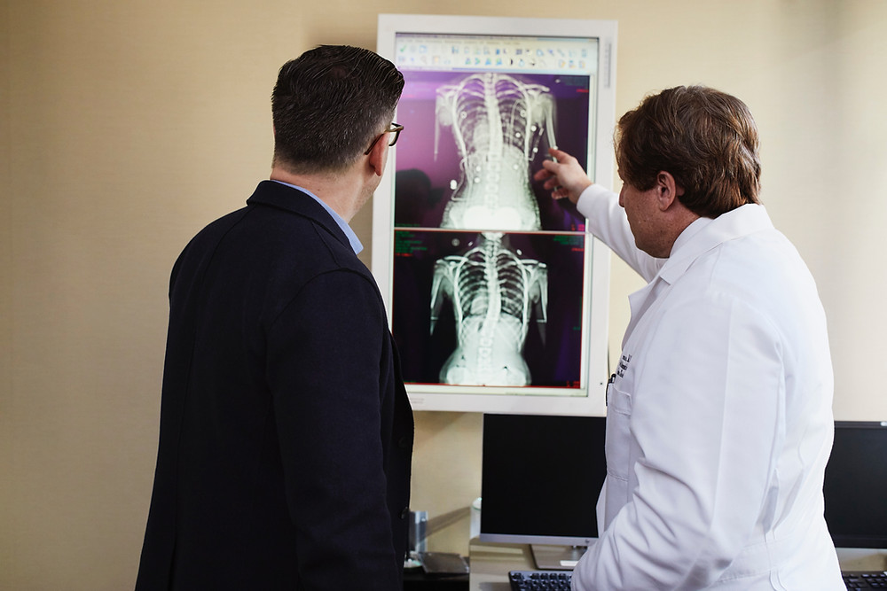 Doctor and patient looking at x-rays