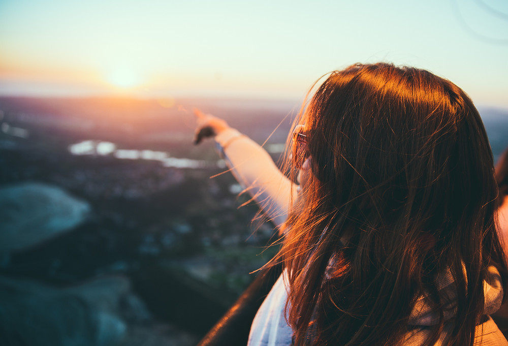 Woman pointing at the horizon