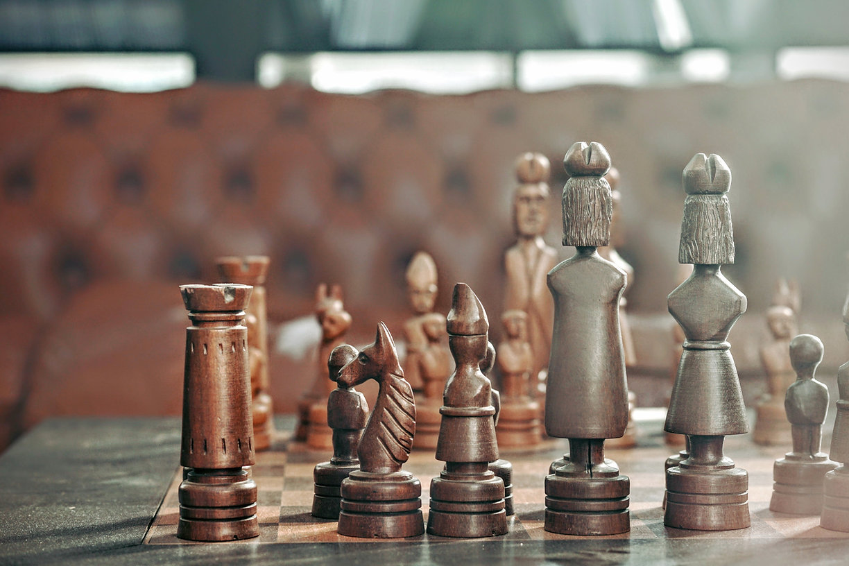 Picture showing wooden chess pieces
