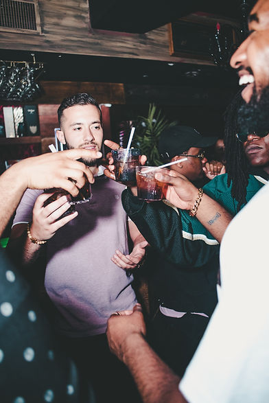 People partying, cheers - Image by John Arano