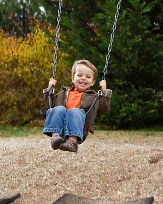Little Boy On The Swings | Georgia Center For Autism And Developmental Pediatrics