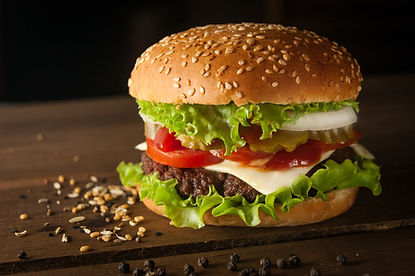 Close up of cheeseburger on table.