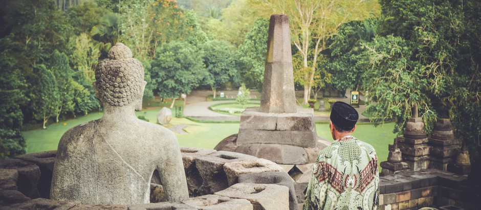 Buddhism should be identified as a religion or philosophy?